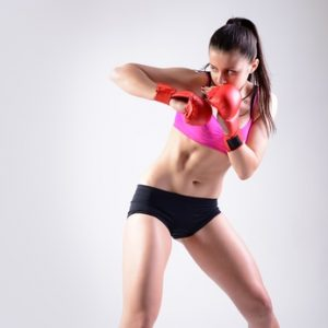sport young woman with combativity gloves going to fighting, act